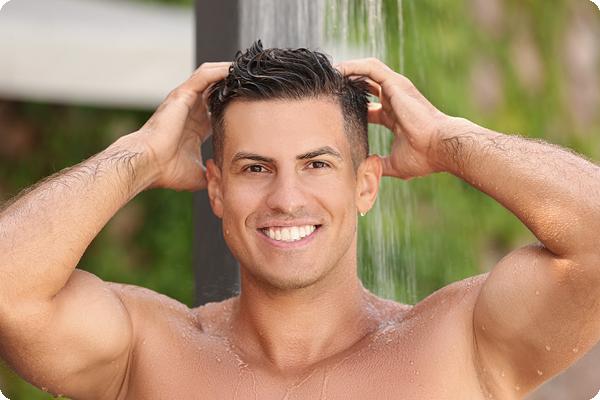 Man taking shower using uScore body wash